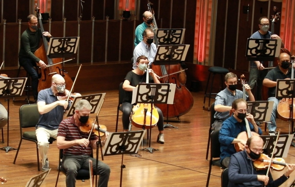 Socially distanced string musicians on the Severance Hall stage in Cleveland