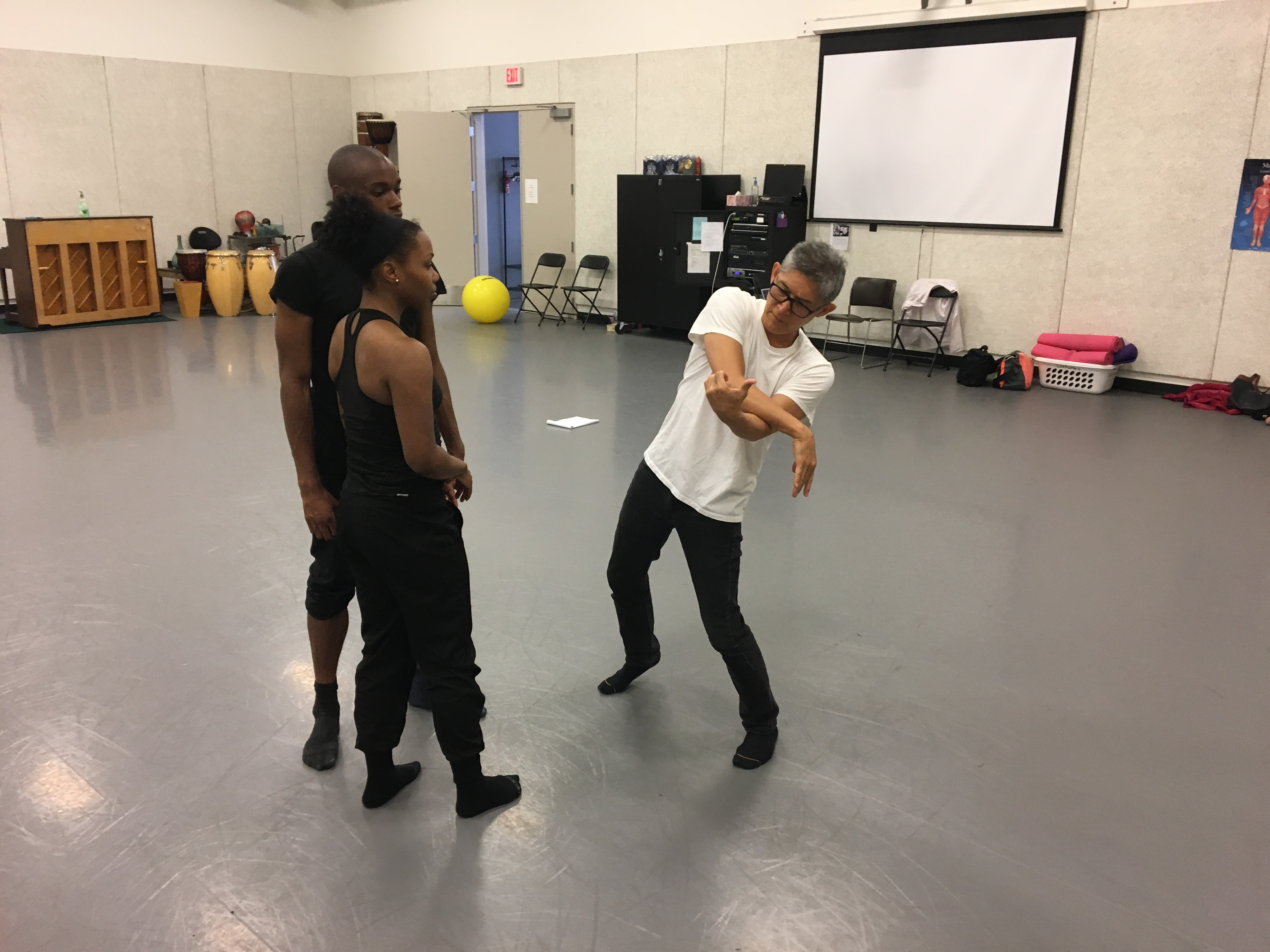 David Shimotakahara working with dancers Alexis Britford and Robert Rubama