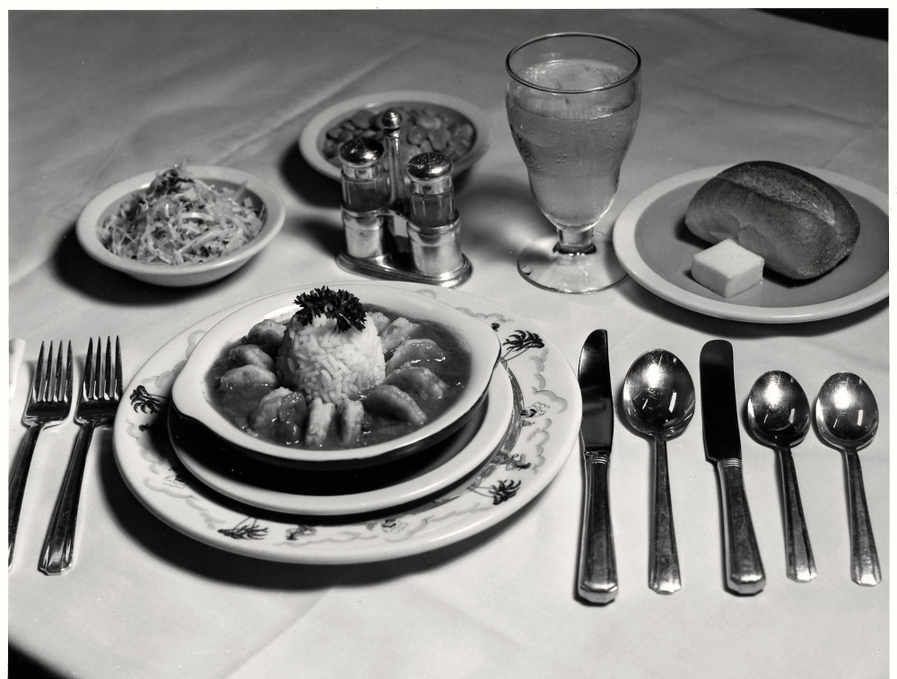 "picture of regional cuisine offered on trains.  Illinois Central Railroad's Chicago-New Orleans ""Panama Limited,"" Shrimp Creole, Seasoned Cole Slaw, and Lima Beans Baked in Mustard Sauce. [Illinois Central Gulf Railroad/James Porterfield]"