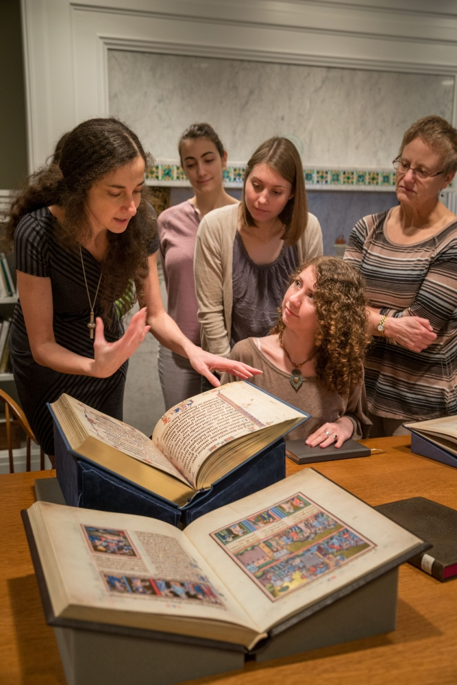 Photo of Elina Gertsman teaching medieval books through facsimiles at the Ingalls Library at the Cleveland Museum of Art [Howard Agriesti/Elina Gertsman]
