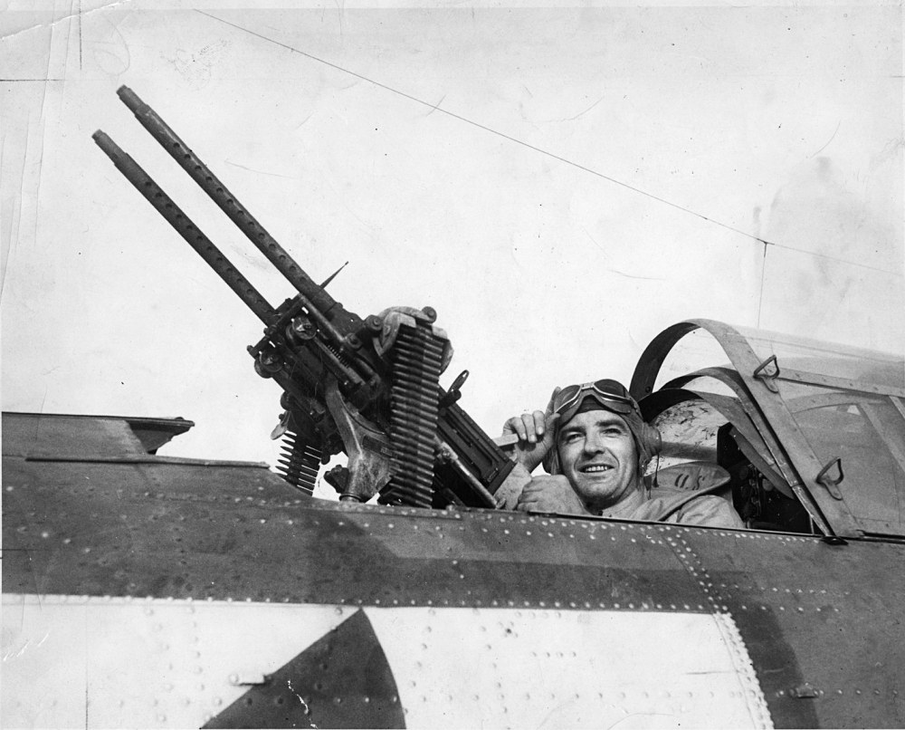 Photo of Joe McCarthy posing in a Douglas SBD Bomber [Wisconsin Historical Society/Houghton Mifflin Harcourt]