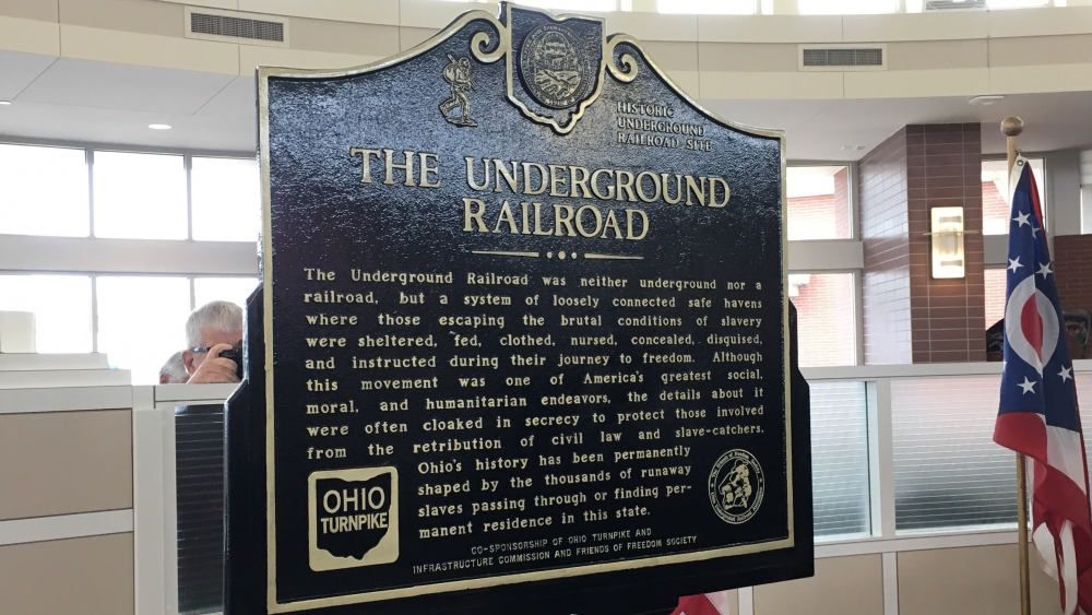 Plaques honoring the Underground Railroad will sit at turnpike rest stops in two Ohio towns. [Gabriel Kramer / ideastream]