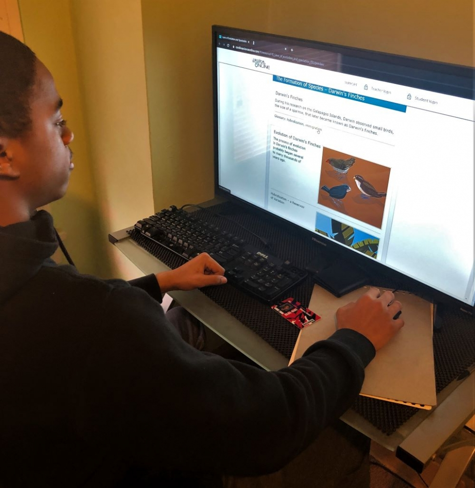 Sophomore Caleb Haynes works on an assignment on his computer at home.