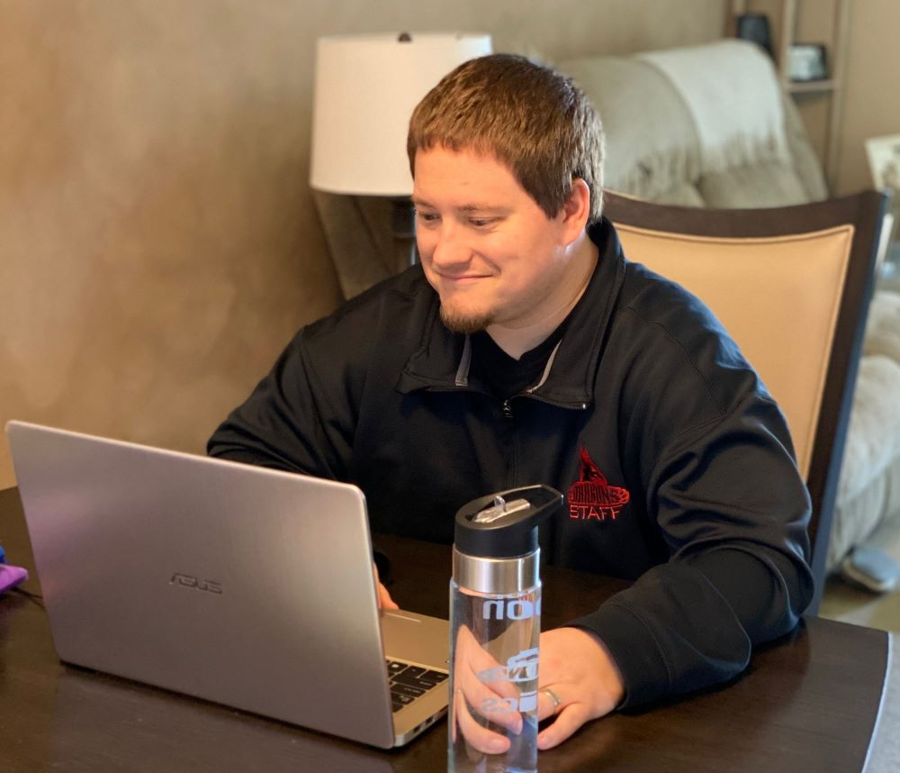 Teacher Dan Horton leads live online sessions with his English students from his home.