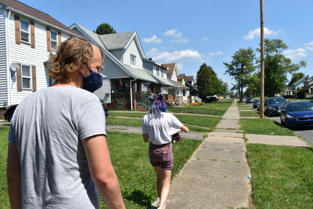 Cleveland DSA members Anna Powaski and Chad Falatic head toward the home of a local renter who faces an eviction case. The group uses public records from the Cleveland Housing Court to find these tenants.