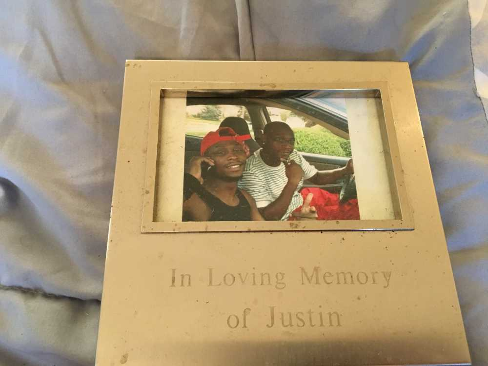 A photograph of Justin Brewer and Jason Brewer reads 'In Loving Memory of Justin.'