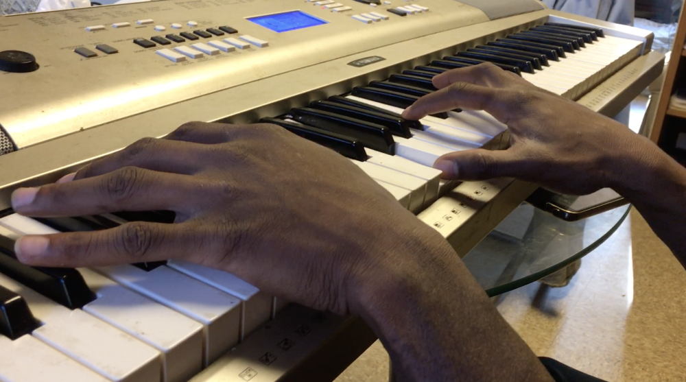 Jason Brewer's hands at the keyboard.