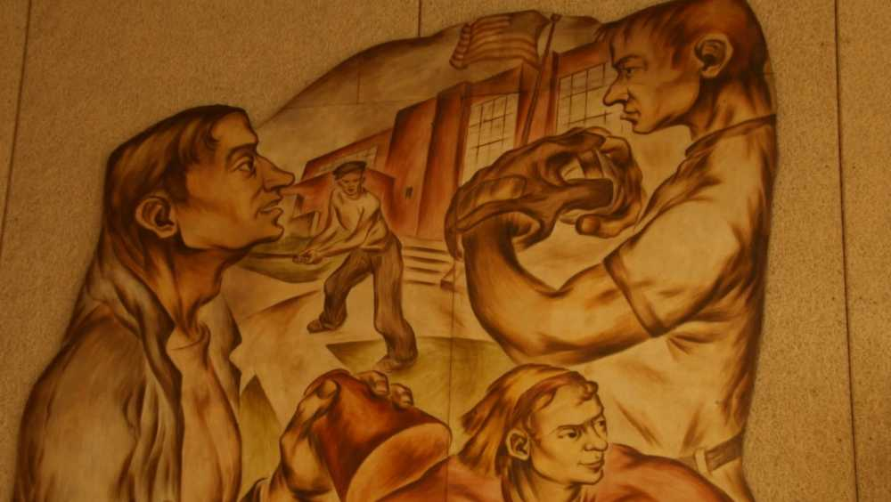 A mural detail shows athletes in front of buildings.