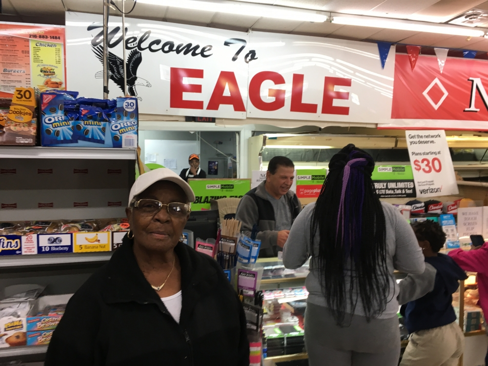 Carolyn Freeman stands in front of a counter at Eagle Supermarket.