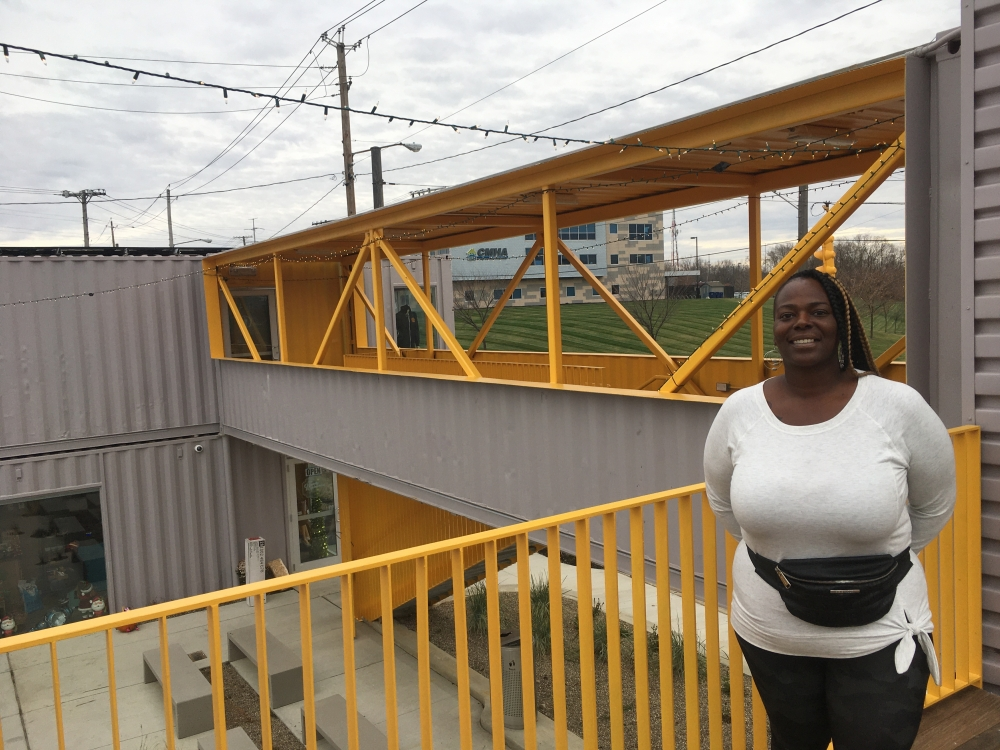 Olympia Robinson stands outside her eyeglass store at BoxSpot.