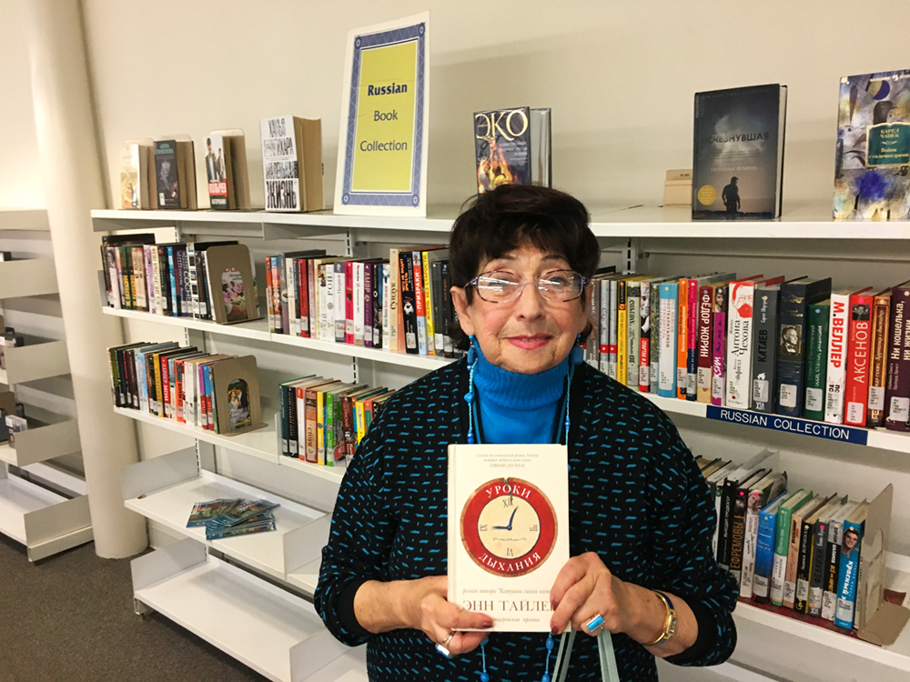 Irina Parkman holds up a Russian translation of Anne Tyler's Breathing Lessons.