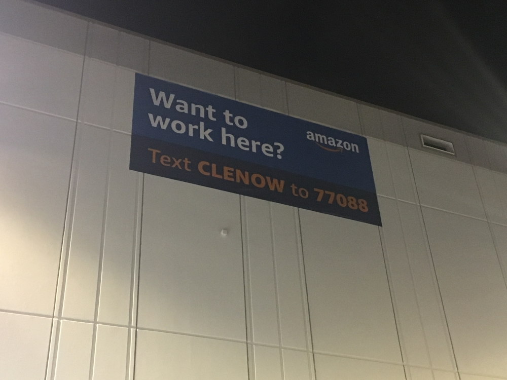 A sign advertises for workers at the Amazon fulfillment center outside Cleveland
