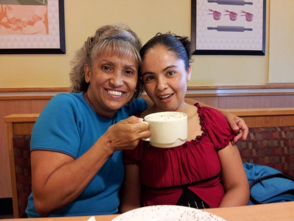 Maria Torres of Cleveland poses with a loved one.