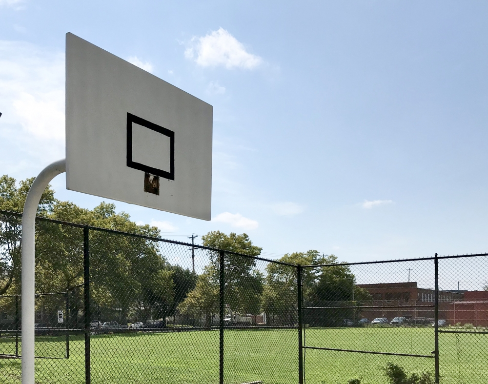 A basketball backboard stands empty at Herman Park in Cleveland.