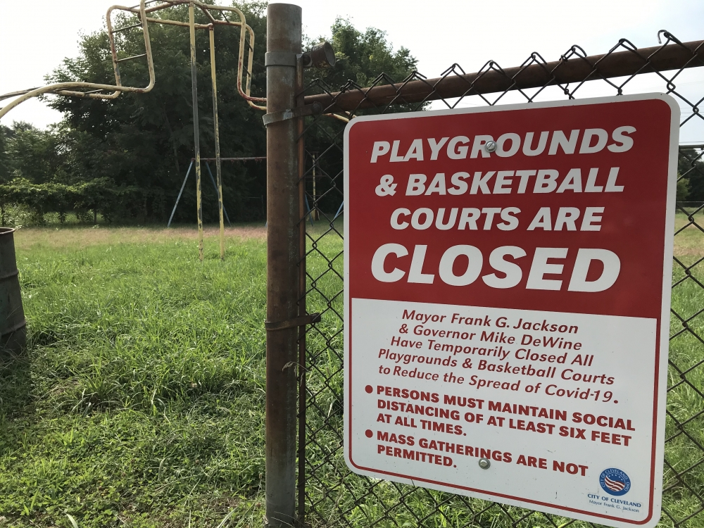 A sign warns that playgrounds are closed in Cleveland.