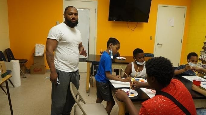 Walter Patton stands with kids in his Create Art Not Violence program.