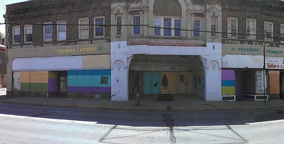 A photograph shows a mural on the Moreland Theatre in Cleveland.