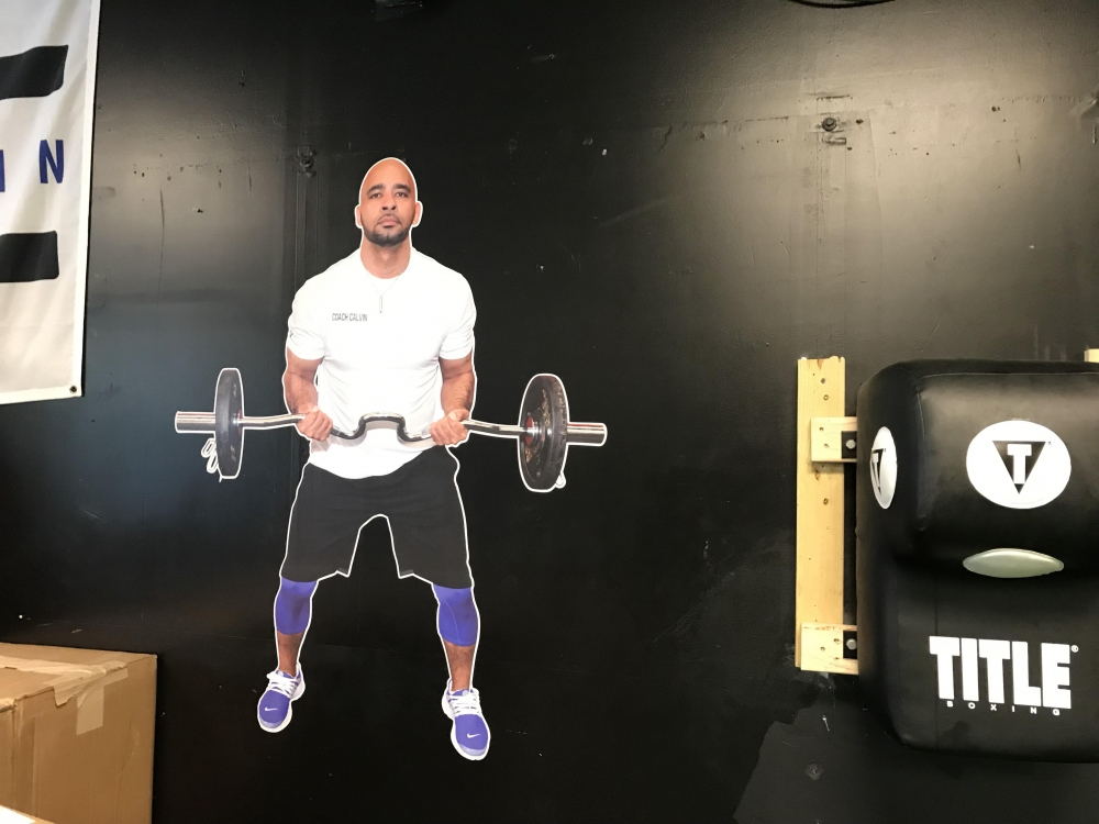 A wall decoration shows Little Giants' owner, Calvin Love.