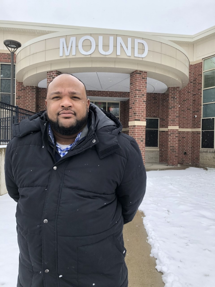 Michael Copeland stands outside Mound STEM school in Cleveland's Slavic Village neighborhood.