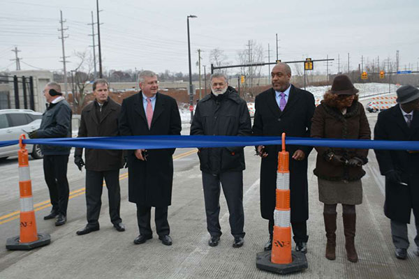 """Cleveland Mayor Frank Jackson and other officials cut the ribbon on a part of the Opportunity Corridor."