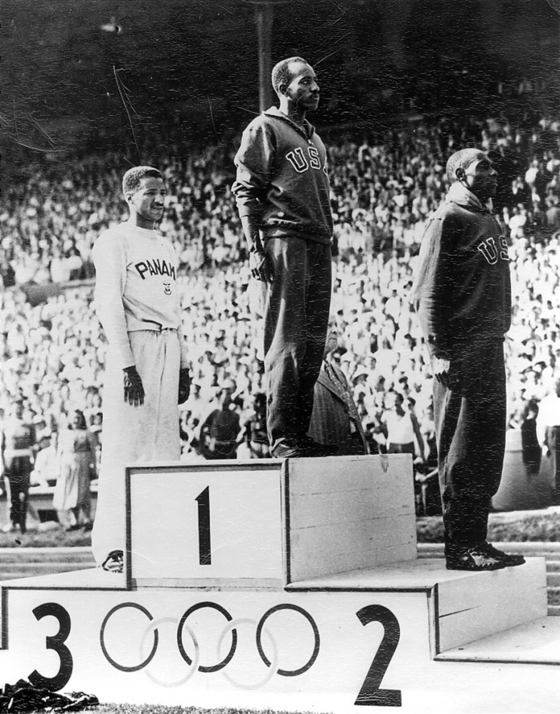 Harrison Dillard standing atop the podium at the 1948 Olympics in London after winning gold in the 100-meter race.