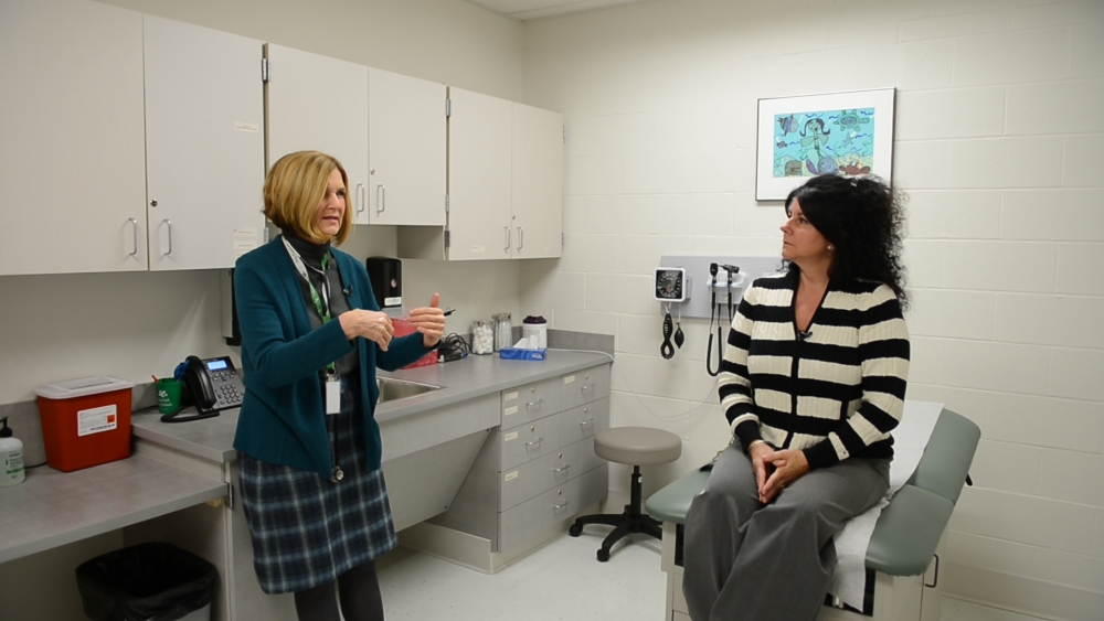 Physician Assistant  Nancy Ivansck meets with Carla Spiceia (Jean-Marie Papoi /ideastream)