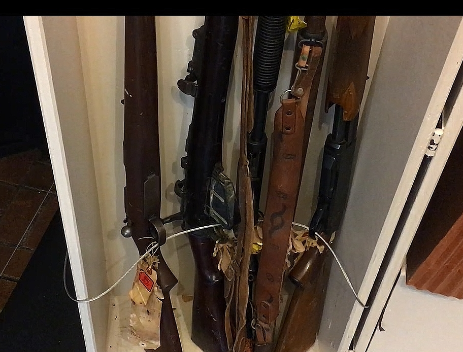 Some of the M-1 and 30.06 rifles that Fred Ahmed Evans purchased in 1968 on display now in the Clevelans Police Museum. (Urycki/ideastream)